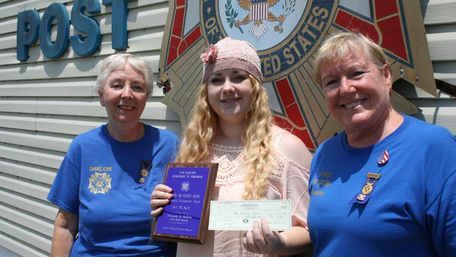 """Brittany Sellers whose painting won first place in the Marion County """" Young American Creative Patriotic Art Awards"""" in April, sponsored by the Bull Shoals VFW Auxiliary Hoevel-Barnett Post 1341 went on to win first place in the State VFW Auxiliary competition. She was recently presented a plaque and a check for $350 by Bull Shoals Auxiliary president Chris Ross, right, and Auxiliary secretary Darlene Brakebill. Brittany's painting will now be submitted to the National Auxiliary competition in Kansas City, Mo., for judging and a chance at winning one of five scholarship prizes from $500 to $10,000."""