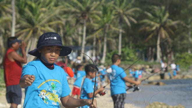 In this July 2016 file photo, a youth competes in the Department of Agriculture's Fishing Derby for Kids held at the Asan War in the Pacific Park.