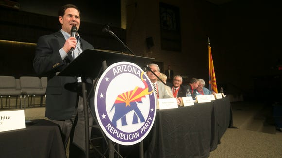 Arizona Gov. Doug Ducey speaks at the Arizona Republican Party's annual meeting at Grace Community Church in Tempe on Saturday, January 22, 2015.