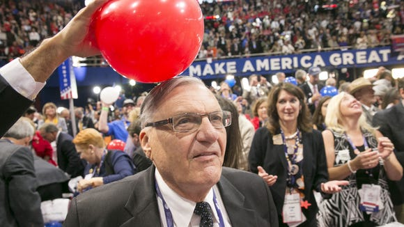 Arizona delegates Joe Arpaio celebrates after Republican Presidential nominee Donald Trump speech during the Republican National Convention at QuickenLoans Arena in Cleveland, Ohio on Thursday, July 21, 2016.