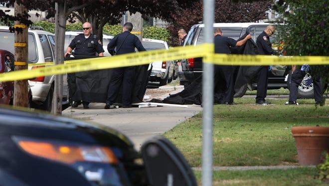 Salinas police respond to a homicide scene on Gabilan Street.
