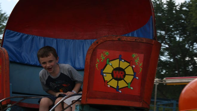Kaiden Terry, 6, of Kirkwood, rides on the tilt-a-whirl.