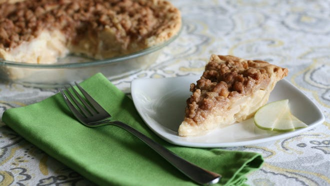 Pears and apples combine in this crumble-topped pie.