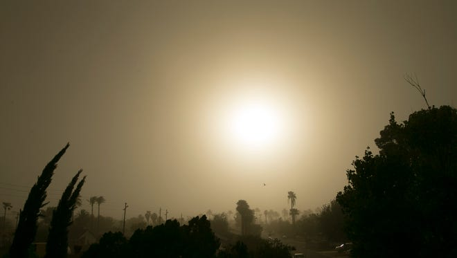 A dust storm comes into central Phoenix on Sunday afternoon, August 21, 2016.