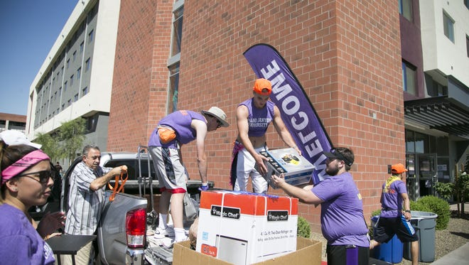 Grand Canyon University student volunteers help  freshman students move into the dorms on Aug. 22, 2016.