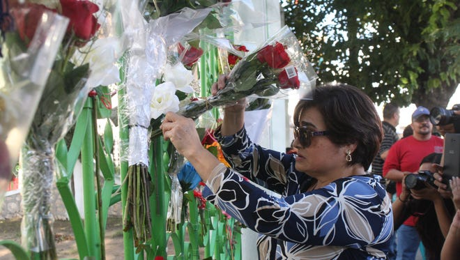 Fans gather outside of Juan Gabriel's house in Juárez after reports that he died in California.