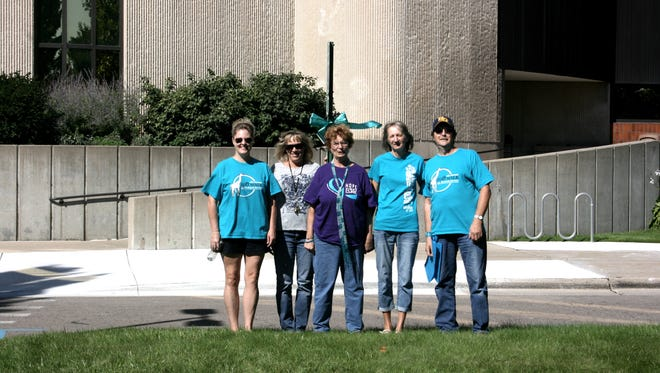 A group of volunteers turned out last weekend to Turn the Town Teal, raising awareness of ovarian cancer.