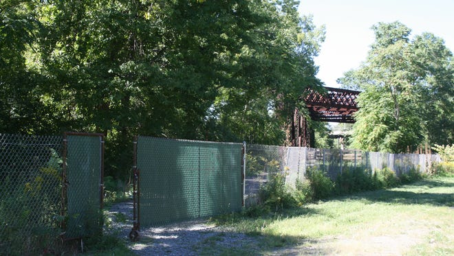 A fence marks where the Lackawanna Trail in Elmira becomes unpaved. Work to pave the section of trail between Elmira and Lowman could be completed by the spring of 2017.