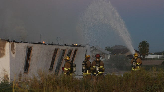 Packs of Buckeye firefighters douse the once abandoned church that caught fire in Buckeye, Ariz. on Sept. 17, 2016.