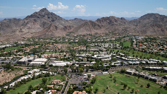 An aerial view of the Arizona Biltmore Hotel and Arizona Biltmore Golf Club in front of Piestewa Peak in Phoenix on July 21, 2016.