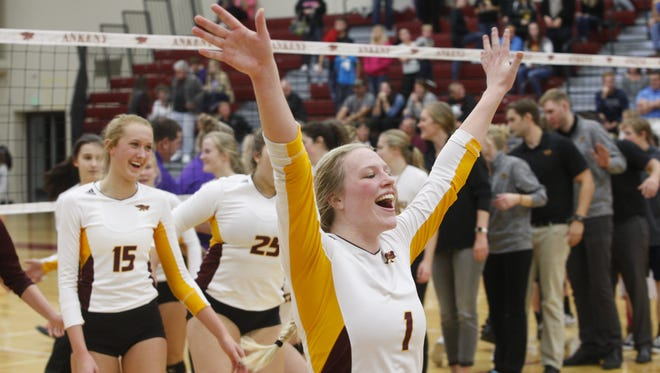 Ankeny senior Alyssa Ballenger celebrates after the Hawkettes defeated Waukee in a Class 5A regional final on Monday at Ankeny.