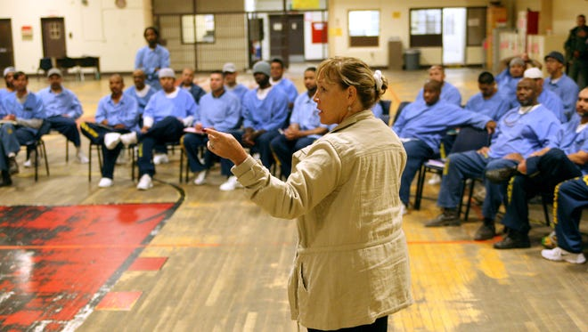 Correctional Counselor Teresa Verdesoto speaks to men at the Correctional Training Facility in Soledad during a recent meeting.