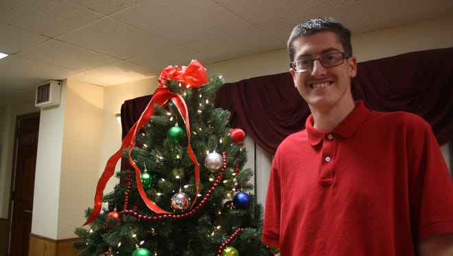 Mike, 24, of Binghamton, attended a Christmas Party hosted by the Binghamton Sons of Italy Lodge 487 and Stella D'Argento Lodge 1916 for residents of the Broome Developmental Center.