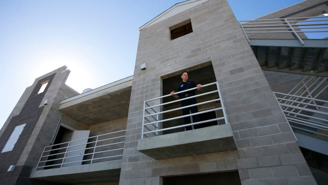 Chandler Fire Chief Tom Dwiggins gives a tour of the new burn tower at the Chandler Fire Department training facility in Chandler. The burn tower will start being used for training by fire departments in January 2017.