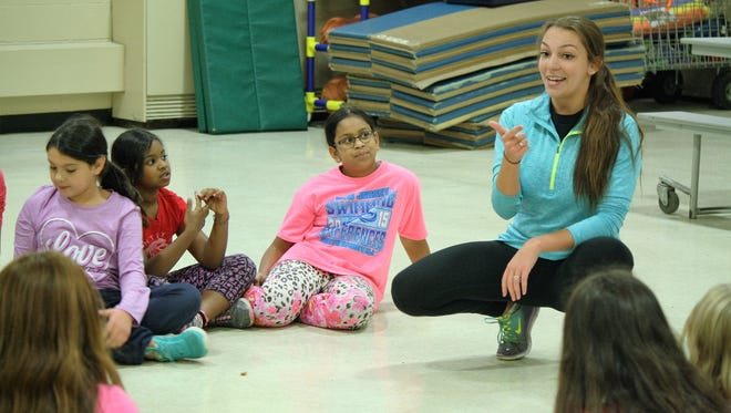 Melissa Denholtz, an instructor with Mason Gross Extension Division, speaks with her students at Robert Frost Elementary School, East Brunswick, during the Creative Movement class after school. The district recently partnered with Mason Gross Extension Division at Rutgers to offer the dance class to students.