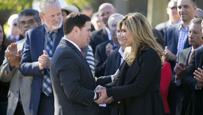 Arizona Gov. Doug Ducey shakes hands with the governor of Sonora, Mexico, Claudia Pavlovich Arellano, at the Arizona state Capitol in Phoenix on Nov. 29, 2016. Parts for Lucid Motors' electric vehicles would be manufactured by suppliers in Sonora.
