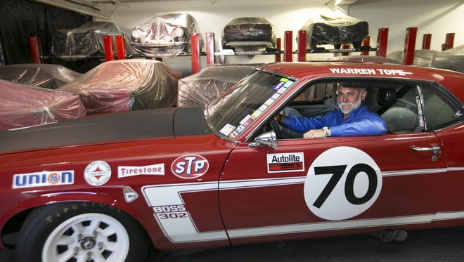 """""""It has grown, but we always kept the auction as the core. It's always been the center focus,"""" says Drew Alcazar of Russo and Steele, the collector car and auction company. Here he's seen in a Ford 1969 Boss 302 Trans-Am, at the Russo and Steele offices."""