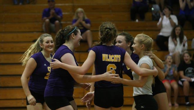 Clarksville High's team gathers in the middle of the court after a point during the District 10 tournament two months ago. The Lady Wildcats got three players on the All Area Volleyball First Team.