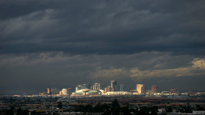 Ominous clouds are seen over downtown Phoenix on Saturday, December 24, 2016.