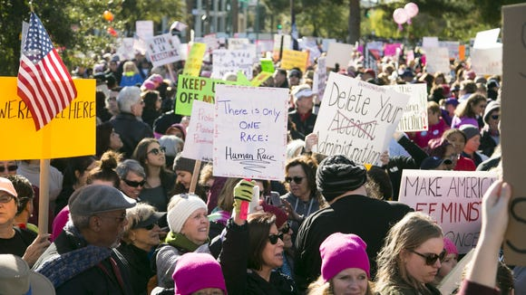 Thousands participate in a march at the Arizona State Capitol in Phoenix on Saturday, Jan. 21, 2017. The rally was timed for the day after President Donald Trump's inauguration and on the same day of a women's march taking place in Washington, D.C.