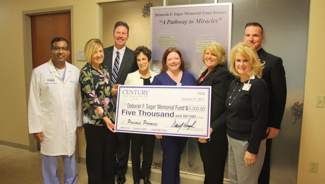 """Muhammad U. Anwar MD from the Deborah F. Sager Neonatal Intensive Care Unit; Debbie Holman and David Hemple from Century Savings Bank; Penny Sager-Rossi from the Deborah F. Sager Memorial Fund; Kristen Carrione, nurse, Deborah F. Sager Neonatal Intensive Care Unit; Dawn Goffredo, Inspira Health Network Director of Nursing for Mother/Child Health; Stephen Cuccini, nurse, Deborah F. Sager Neonatal Intensive Care Unit; and Carolyn Heckman from the Inspira Foundation Cumberland/Salem are pictured at the check presentation for the first year of Century Savings Bank's """"Preemie Promise"""" campaign to benefit the Deborah F. Sager Memorial Fund/Inspira Health Network's Deborah F. Sager Neonatal Intensive Care Unit."""