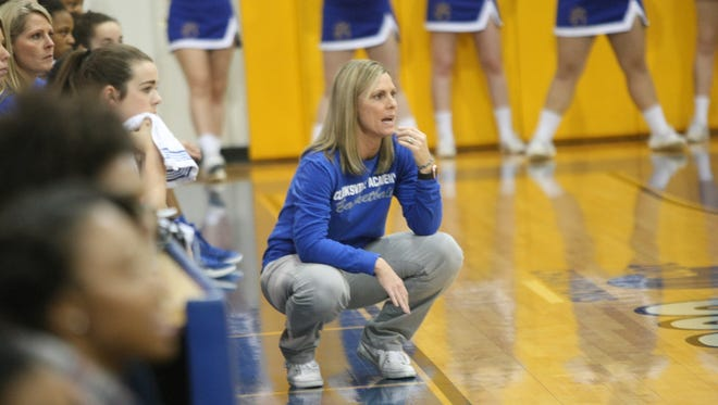 Clarksville Academy girls coach Carrie Daniels watches her team take on LEAD Academy in the first round of the District 10-A girls basketball tournament Monday.