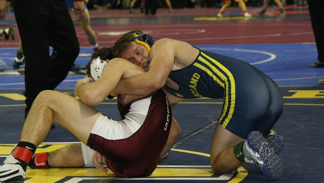 Hartland's Joey Livingston, right, wrestles at 160 pounds Thursday at the Palace.