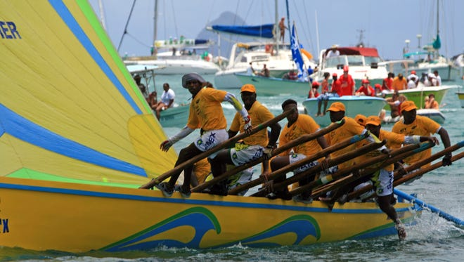 """""""A true Caribbean"""" is the compliment I received for sailing a Martinican yole during a practice. Yole racing is more beloved on Martinique than mardi gras. The boat has no keel so it has to keep moving or it will capsize. It's steered with an oar, and balanced with five crew on either side ride on wooden poles, providing balance and ballast."""