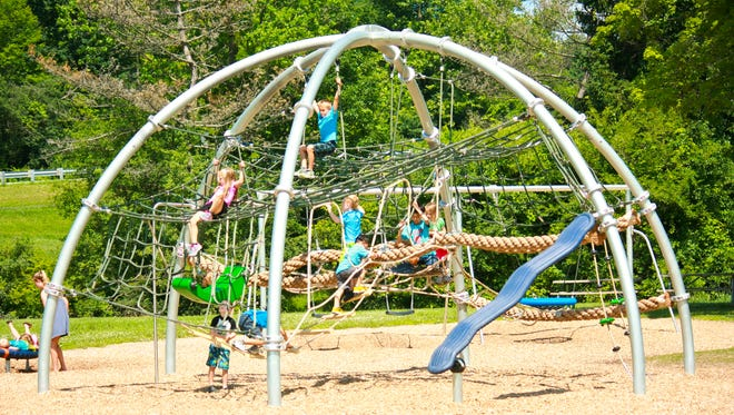 Doesn't it look fun? Kids busy themselves on a playscape at Waterford Bend Park in Nortrhville.