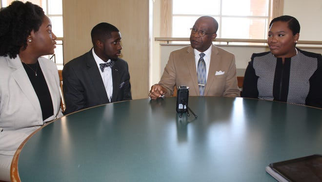 Hattiesburg High School students Sharee Thomas, Kerrington Anderson and Chrystal Wilson interview Hattiesburg Mayor Johnny DuPree for an oral history project being done in collaboration with the University of Southern Mississippi. The project examines the history of segregation and desegregation of Hattiesburg's public schools.