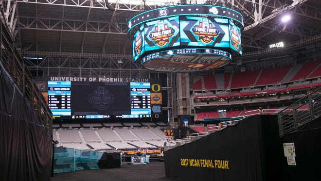 The scoreboard above the NCAA Final Four court at University of Phoenix Stadium in Glendale on Thursday, March 30, 2017.