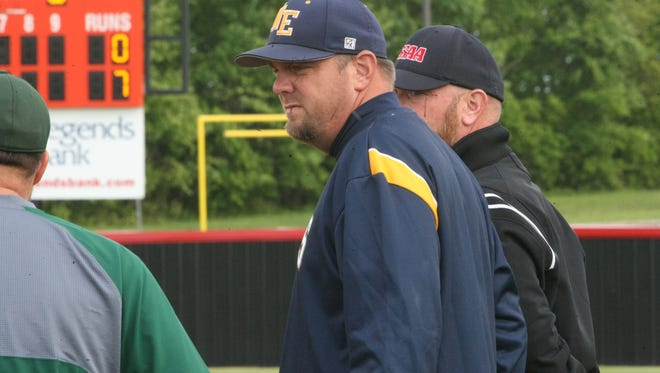 Northeast coach Dustin Smith talks with Northwest coaches during their District 10-AAA tournament game last week. The Eagles knocked off Rossview Monday.