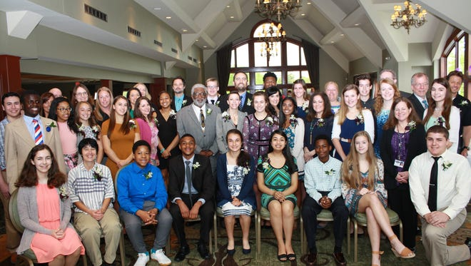 Students and staff member honorees pose for a group picture at the conclusion of the breakfast.