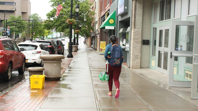 Court Street in Binghamton saw few pedestrians Tuesday after an afternoon rain storm.