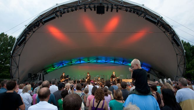 Concertgoers dance at the front of the stage at Conner Prairie during the Marsh Symphony on the Prairie: Classical Mystery Tour - Music of the Beatles, Aug. 13, 2011.