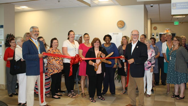 Former Open Door Health Services' CEO, Toni Estep was honored on June 15 with a lobby rededication.