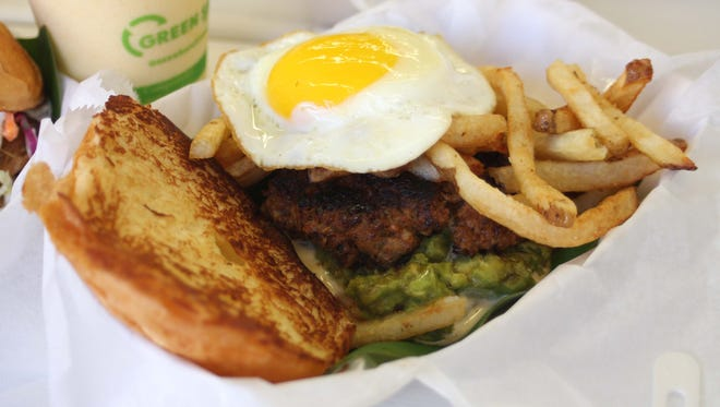 At cool-and-casual Frita Batidos in Ann Arbor, chef-owner Eve Aronoff serves creative variations on the french-fry-and-chorizo  Cuban burgers, called fritas, she loved as a child in Miami. This one keeps the traditional chorizo and fries but kicks up the combo with a sunny-side egg and avocado spread.  Beside it is one of the  frosty tropical shakes called batidos; they're a classic pairing.