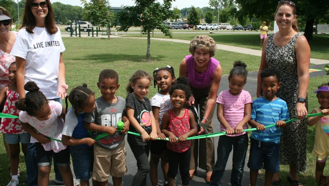 Youngsters from the Lafayette Road Head Start gathered Wednesday with Mayor Kim McMillan at Liberty Park for the grand opening of the Born Learning Trail, a United Way sponsored interactive set of activities for young children and their caregivers.