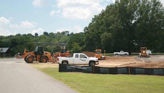 Construction is under way on a 130-space parking lot in the southwest corner of Liberty Park.