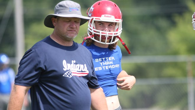 Montgomery Central coach Jeff Tomlinson talks with his quarterback Madison Murphy during the start of their 7-on-7 competition Friday morning at Indians Stadium.