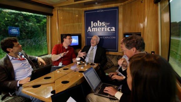 Republican Sen. John McCain talks with reporters as