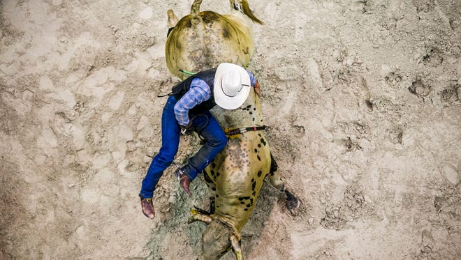 A bull rider competes in the Professional Bull Riders Touring Pro Division at Germain Arena on Friday, July 28, 2017.