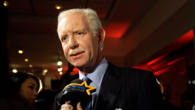 "In this file photo from Jan. 5, 2010, Chesley Sullenberger responds to questions during a news interview as he arrives for the screening of a documentary entitled ""Brace for Impact,"" in New York."