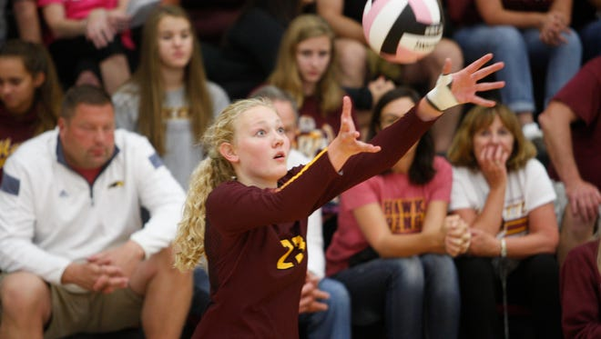 Ankeny's Phyona Schrader serves the ball during the Hawkettes' loss to Red Oak at the Ankeny Centennial Invitational on Aug. 26.