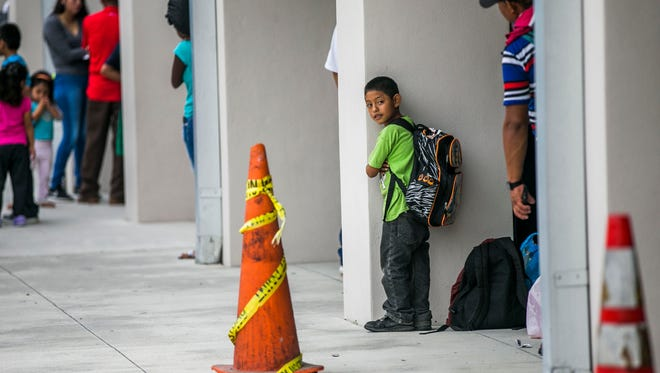 Pedro Mendez, 6, waits in line for shelter at Pinecrest Elementary School in Immokalee as Hurricane Irma approaches on Saturday Sept. 9, 2017.