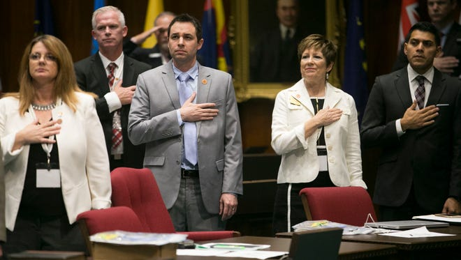 The Arizona delegation Rep. Kelly Townsend (from left), House Speaker JD Mesnard, Sen. Nancy Barto and Sen. Steve Montenegro, recite the Pledge of Allegiance in the House chambers at the Arizona Capitol in Phoenix on Sept. 12, 2017.