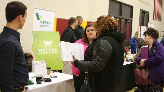 """""""Central Wisconsin Job Fair"""" attendees are pictured talking to potential employers. This fall's event will be held Sept. 20, on the Wisconsin Rapids campus of Mid-State Technical College."""