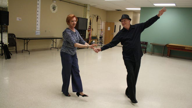 Francine Stein and Chuck Williamson are both dance teachers and partners.