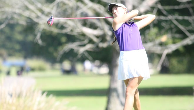 Clarksville High's McKinley Cunningham takes a swing off the tee on the No. 18 hole during the Region 5, Large School tournament Monday at Swan Lake.