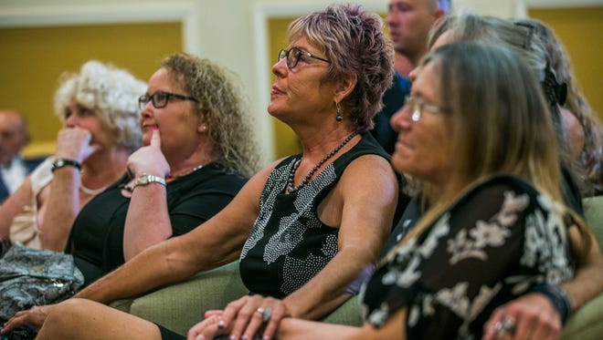 Martha Daniels, center, mourns during the funeral service for her nephew Devan Rewis, 31, of Chokoloskee at Hodges Funeral Home in Naples on Saturday, Sept. 30, 2017